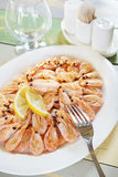 Cooked shrimps in a large plate on the table Royalty Free Stock Photo