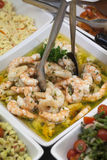 Cooked shrimps in parsley vinaigrette Stock Images