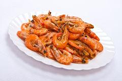Cooked shrimps on plate. Cooked shrimps on white plate Stock Photo