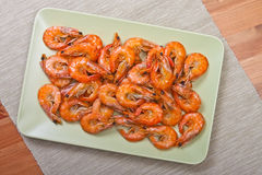 Cooked shrimps on plate. Cooked shrimps on green plate Stock Photos