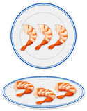 Cooked shrimps on plates Stock Images