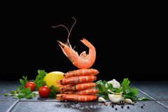 Cooked shrimps,prawns. With seasonings on stone background royalty free stock photo