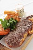 Cooked sirloin steak meal Royalty Free Stock Images