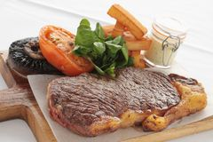 Cooked sirloin steak meal Stock Photo