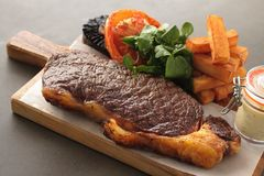 Cooked sirloin steak meal Royalty Free Stock Photos
