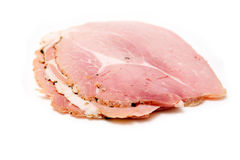 Cooked sliced ham on white  Stock Photos