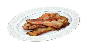 Cooked smoked bacon on platter Stock Image