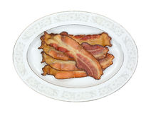 Cooked smoked bacon slices on platter Stock Image