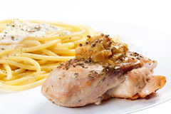 Cooked spaghetti  cream sauce with grilled chicken breast. Stock Images