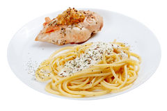 Cooked spaghetti with cream sauce with grilled chicken breast. Royalty Free Stock Images