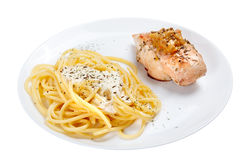 Cooked spaghetti with cream sauce with grilled chicken breast. Stock Image