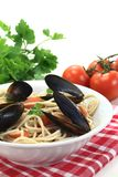 Cooked Spaghetti with mussels and parsley Royalty Free Stock Photo