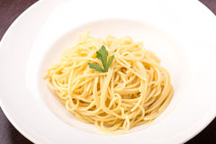 Cooked spaghetti pasta. Isolated on wooden background Royalty Free Stock Photography
