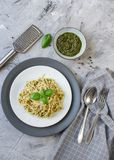 Cooked spaghetti pasta on a plate with basil pesto and Parmesan cheese, Italy food. Healthy concept, vegetarian stock images