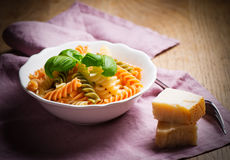 Cooked spiral macaroni with basil Royalty Free Stock Photos