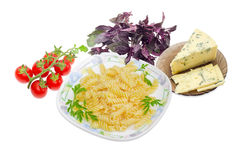 Cooked spiral pasta, cherry tomatoes, blue cheese and greens Royalty Free Stock Image
