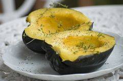 Cooked squash. Close-up of a cooked squash, butter and thyme leaves. Nice presentation for recipe book. Focus only on the middleground to diversity from classic royalty free stock photography