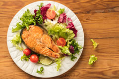 Cooked steak salmon with vegetables. Top view Stock Image
