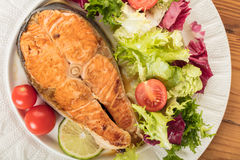 Cooked steak salmon with vegetables. Top view Stock Photo