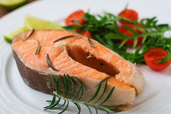 Cooked on steam salmon steak with vegetables. Dietary menu. Proper nutrition Stock Photo