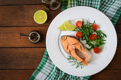Cooked on steam salmon steak with vegetables. Dietary menu. Proper nutrition. Top view Royalty Free Stock Photo