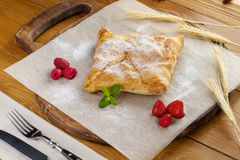 Cooked sweet khachapuri with raspberries and strawberries Stock Photography