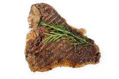 Cooked T-bone steak on white Royalty Free Stock Images