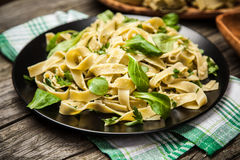 Cooked tagliatelle on a plate Royalty Free Stock Photo