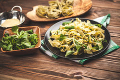 Cooked tagliatelle on a plate Stock Images