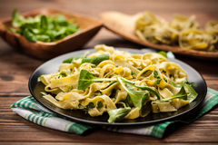 Cooked tagliatelle on a plate Royalty Free Stock Images