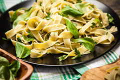 Cooked tagliatelle on a plate Stock Photography