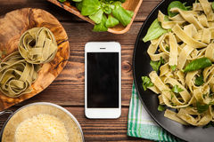 Cooked tagliatelle on a plate Royalty Free Stock Photos