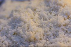 Cooked thai jasmine rice background. Jasmine rice or Khao hom mali also known as aromatic rice that grown primarily in Thailand T. Hai hom mali or Thai fragrant Stock Photo
