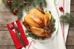 Cooked turkey with garnish served for Christmas dinner on table. Flat lay royalty free stock photography