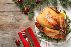 Cooked turkey with garnish served for Christmas dinner on table, flat lay. Space for text royalty free stock photography