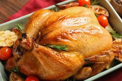 Cooked turkey with vegetables and rosemary in dish on table. Closeup royalty free stock images
