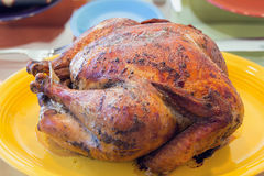 Cooked Turkey on Yellow Platter Royalty Free Stock Images