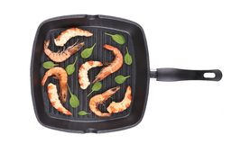 Cooked unshelled shrimp on frying pan. Stock Image