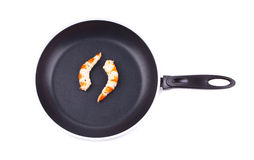 Cooked unshelled shrimp on frying pan. Royalty Free Stock Photography