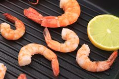 Cooked unshelled shrimps on frying pan. Stock Photography