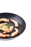 Cooked unshelled shrimps on frying pan. Royalty Free Stock Photos