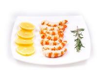 Cooked unshelled shrimps with lemon. Stock Photo