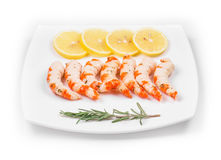 Cooked unshelled shrimps with lemon. Royalty Free Stock Image