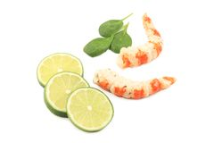 Cooked unshelled shrimps with spinach. Stock Photography