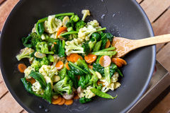 Cooked vegetables into chinese food capcay. Top view portrait of cooked vegetables into chinese food capcay Stock Photos