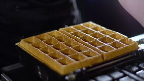 Waffles are taken from a waffle iron / cooked waffles