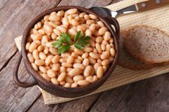 Cooked white kidney beans in a bowl closeup horizontal top view stock photo