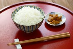Cooked white rice with pickled radish, japanese food Stock Photos