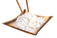 Cooked white rice and wood sticks Royalty Free Stock Photo