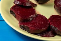 Cooked Whole Beet On The Plate Above Blue Wooden Boards. Agriculture, autumn, background, beetroot, boiled, bowl, crop, cut, diet, dish, farm, food, fresh stock photos